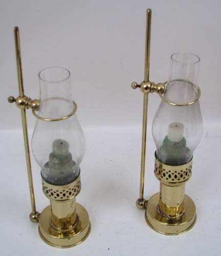 660: Two brass candle lamps with glass hoods