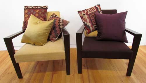 12: Two  Ligne Roset wood and upholstered lounge chairs
