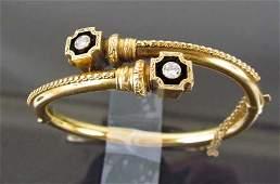 241: Vintage14 K yellow gold bangle bracelet with 2 dia