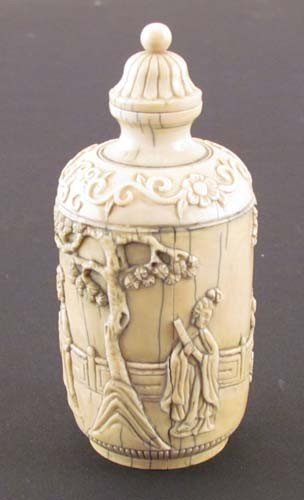 304: Ivory snuff jar with carved relief