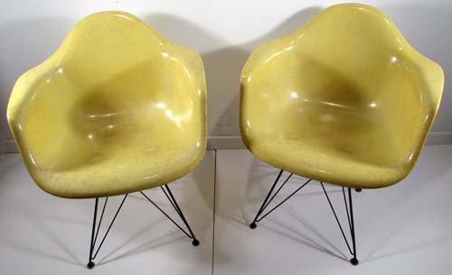 535: 2 Eames Herman Miller fiberglass chairs (yellow) E