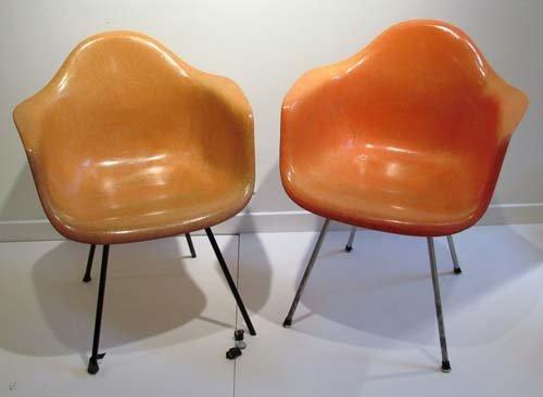 536: 2 Eames Herman Miller fiberglass chairs (orange se