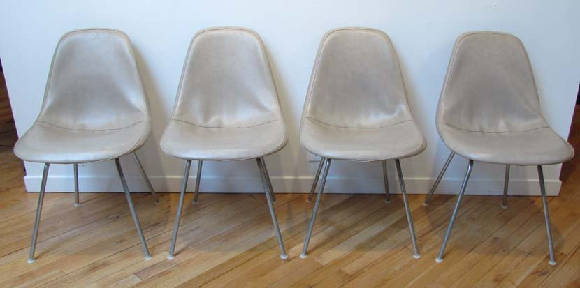 461: Four Eames Shell Chairs w/vinyl covers