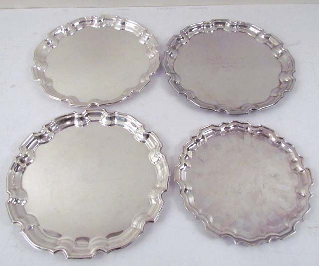 2: 3 pewter platters and 1 silver plated platter
