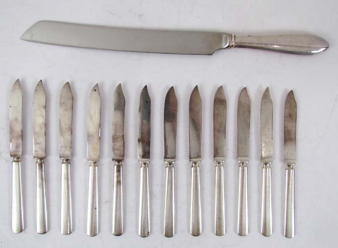 4: Silver plated bread knife and 12 butter knives