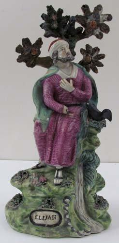 "513: Staffordshire glazed ceramic ""Elijah with Ravens"""