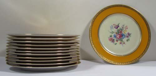 520: 12 painted LIMOGES PORCELAIN PLATES by CHARLES J.