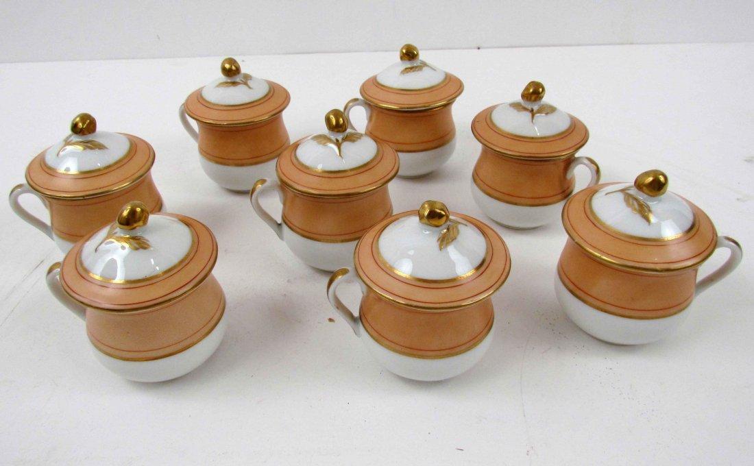 8 lidded demitasse cups with flower detail on lid