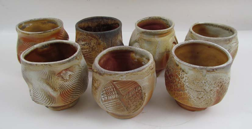 7 Jack Troy ceramic teacups and one Coffee