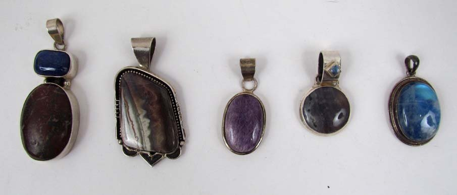 1  R. Begay Sterling pendant with set stone & 4 others