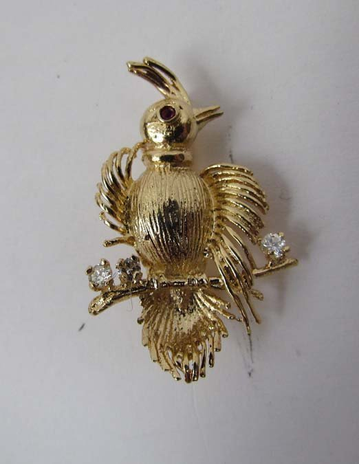 Gold Plumed bird pin with ruby eye and diamonds
