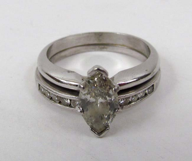 Platinum double ring with .85 carat Marquis cut center
