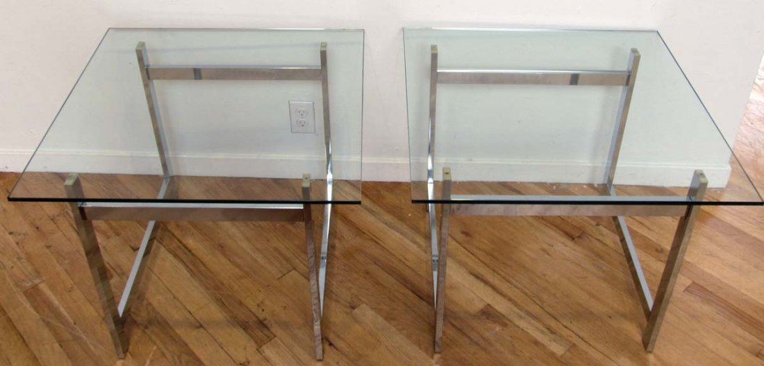 Matching pair of modernist chrome and glass side tables