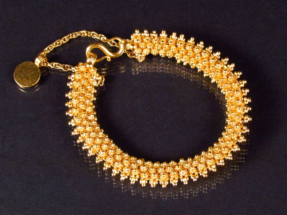 .999 Yellow Gold Flexible Bracelet with Safety