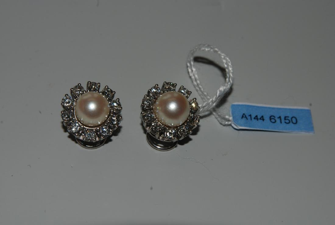 Perlen-Brillant-Ohrclips Bucherer. 2 Akoya-Kulturperlen