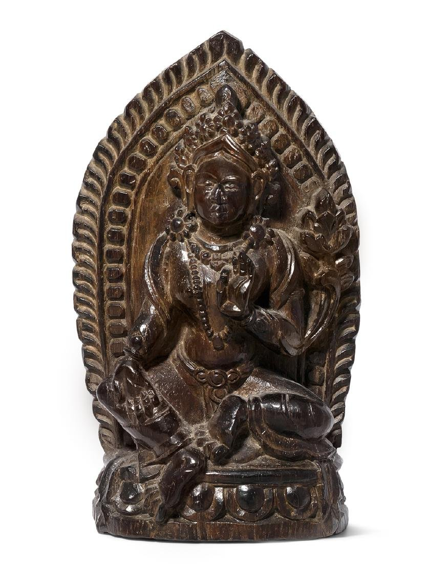 Votivfigur Tibet. 19./20.Jh. Zitan oder Ebenholz. Grüne