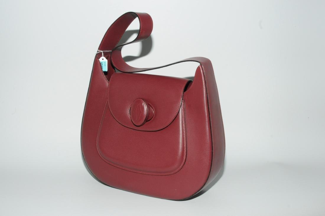 "Cartier, Handtasche Aus der Linie ""Must de Cartier""."