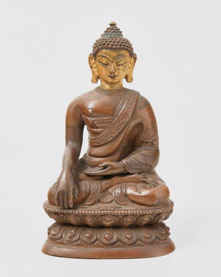 Buddha Shakyamuni Nepal. Kupferlegierung. Das Gesicht