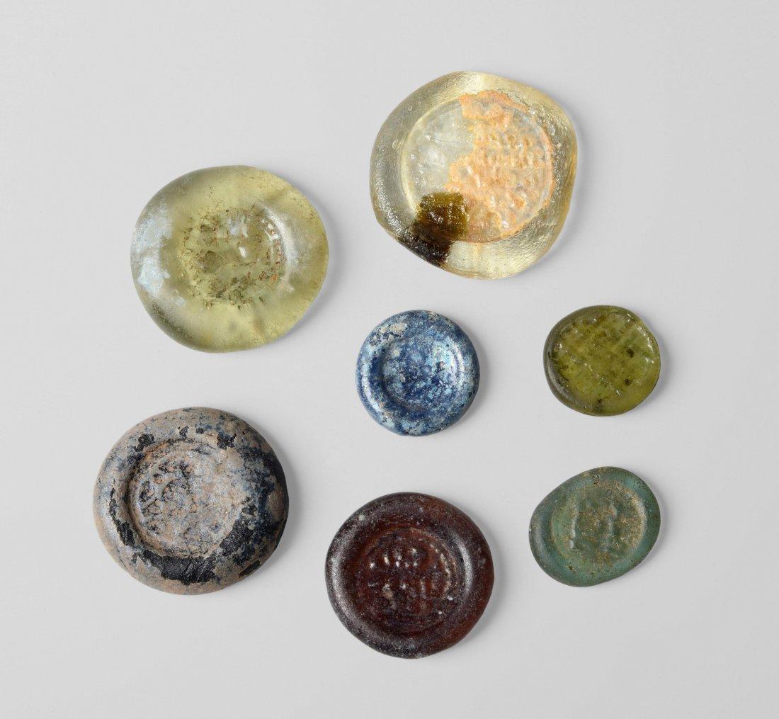 7 Glasmünzen Fatimidisch, um 900 n.Chr.. Runde Scheiben