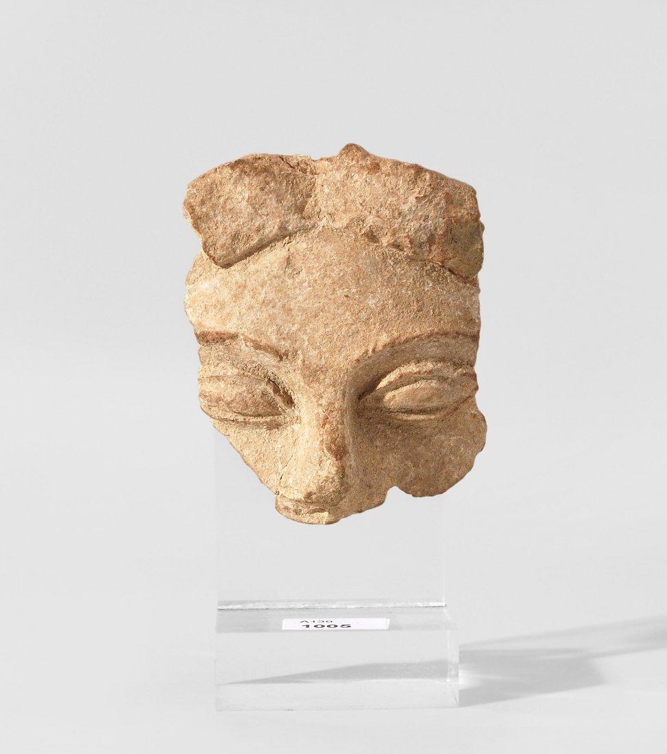 Fragment eines Kopfrelief Sizilien, 6./5.Jh. v. Chr.