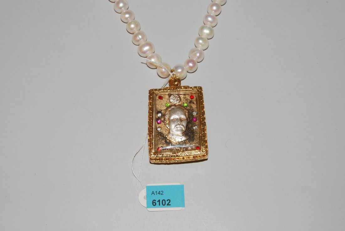Buddhistisches Amulett Thailand. Tonrelief mit