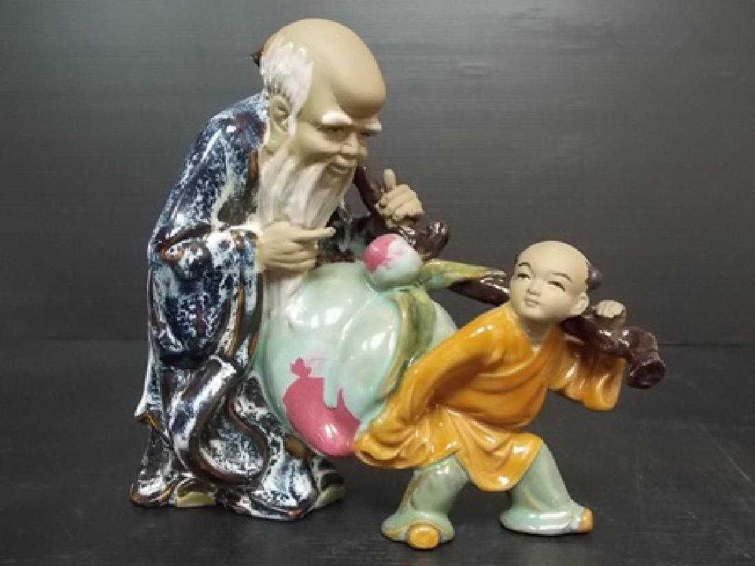 VINTAGE CHINESE MUDMAN FIGURE W/ CELADON GLAZE