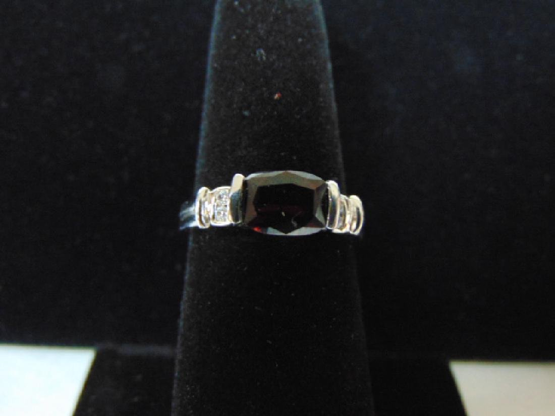 EXQUISITE STERLING SILVER RING WITH RUBY LIKE STONE