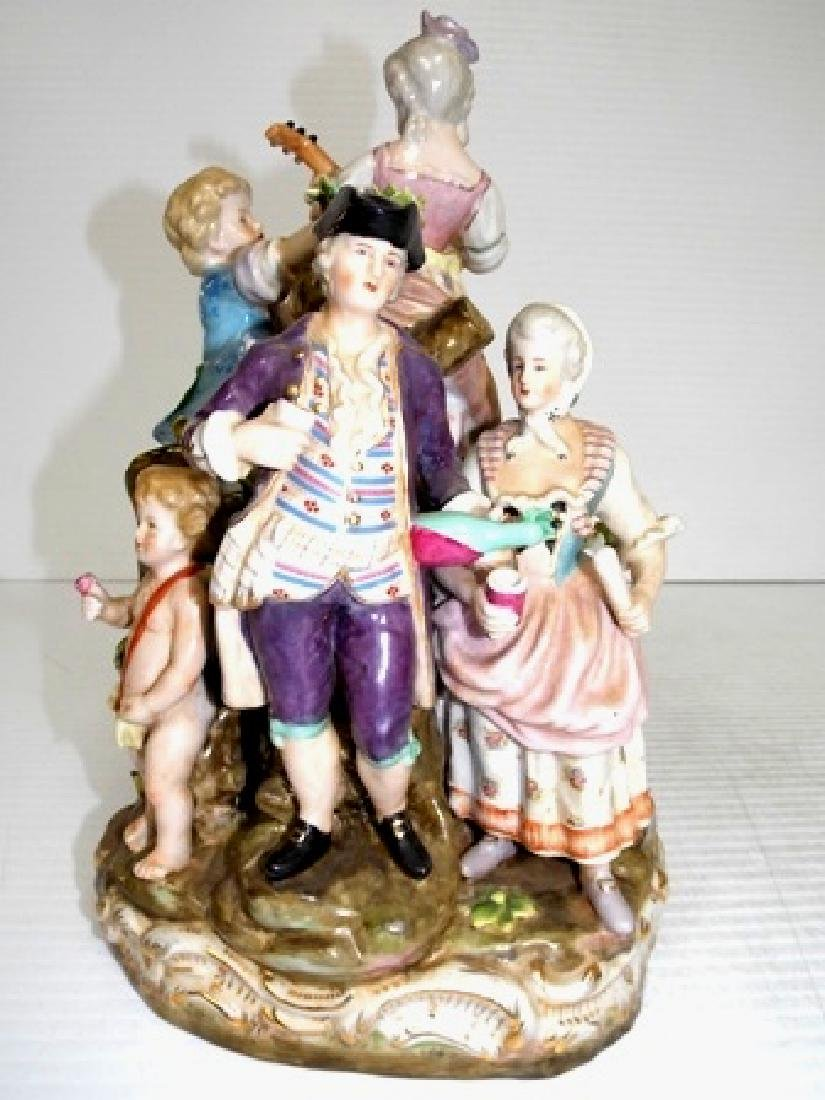 HAND PAINTED PORCELAIN FIGURINES ON AN OUTDOOR MOUND