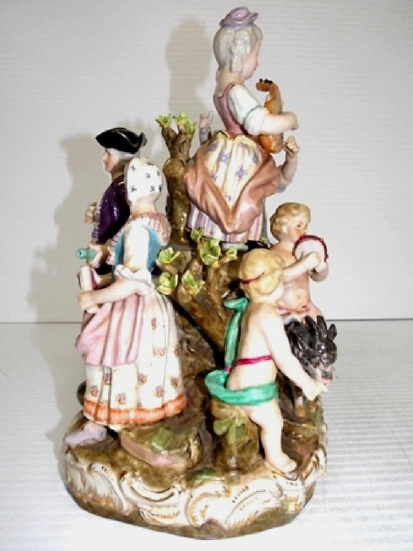 HAND PAINTED PORCELAIN FIGURINES ON AN OUTDOOR MOUND - 3