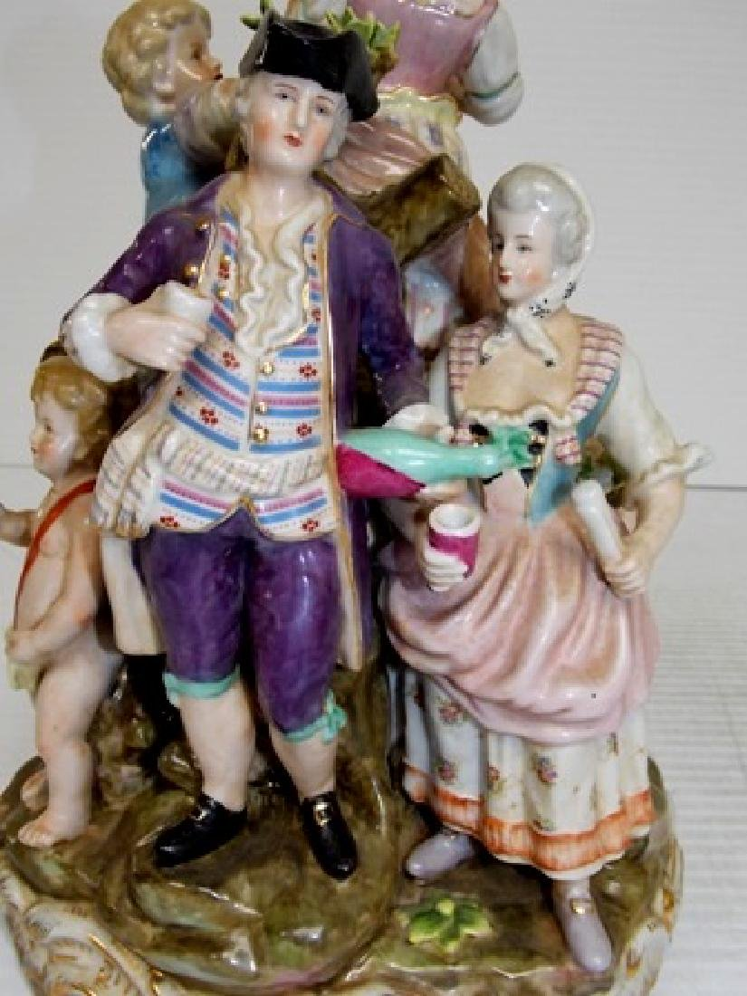 HAND PAINTED PORCELAIN FIGURINES ON AN OUTDOOR MOUND - 5