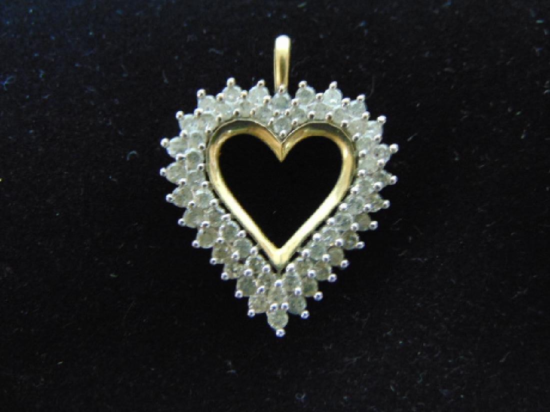 WOMENS VINTAGE ESTATE 10K GOLD HEART PENDANT W/ DIAMOND