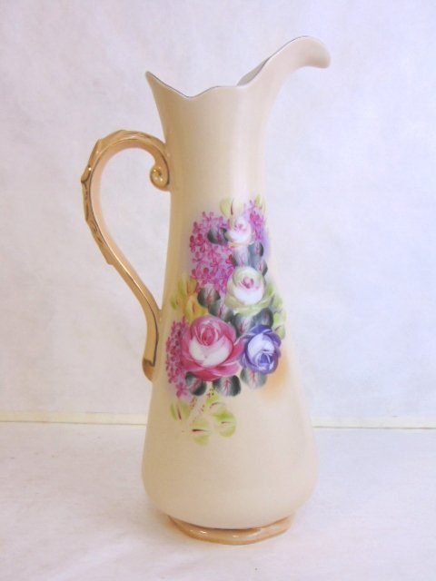 HAND PAINTED PORCELAIN PITCHER WITH FLORAL MOTIF