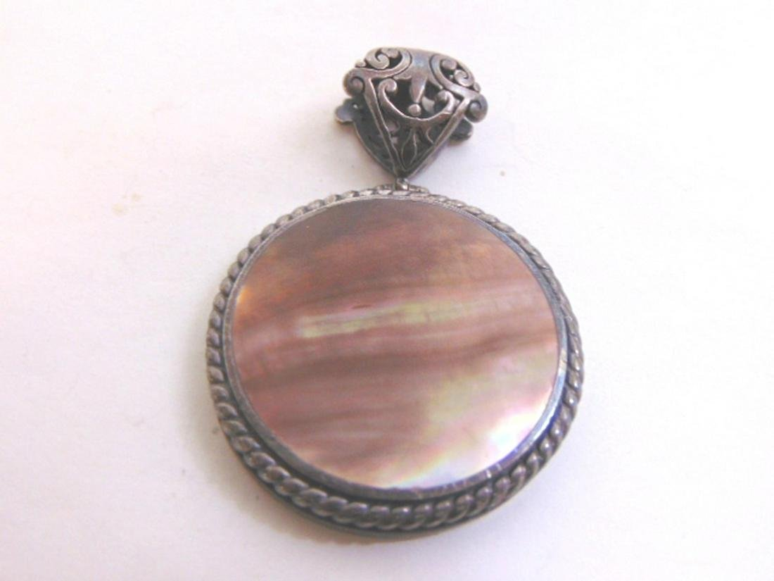 Sterling Silver Pendant by Ex Ex Claudia Agudelo
