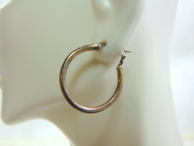 Single Woman's Vintage Sterling Silver Hoop Earring