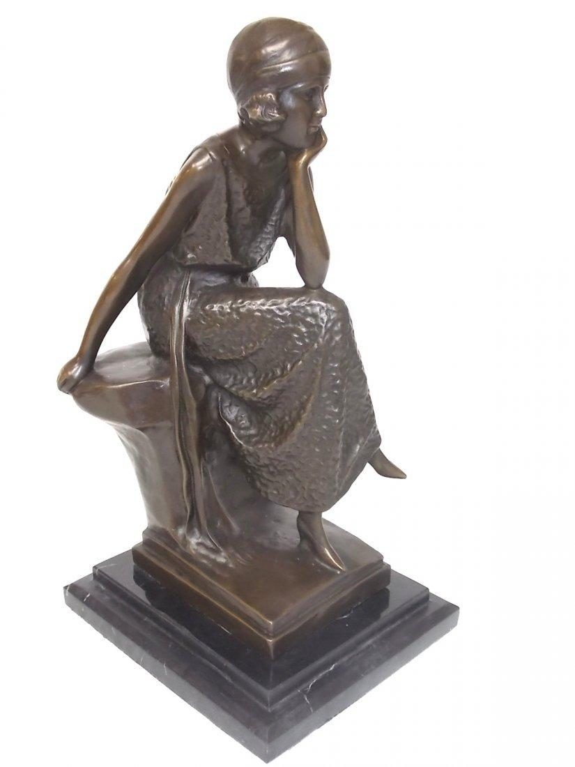 A DECORATIVE BRONZE ART DECO STATUE OF A FLAPPER WOMAN