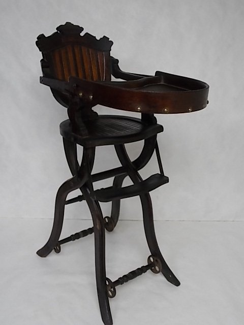 1870'S EASTLAKE VICTORIAN WALNUT COLLAPSE BABY CHAIR