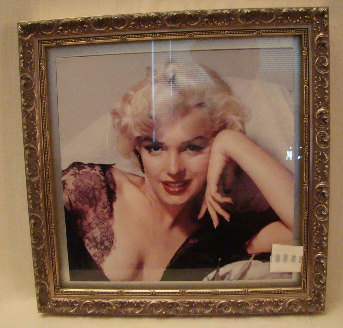 Pair of Marilyn Monroe framed Calendars in a silver fra