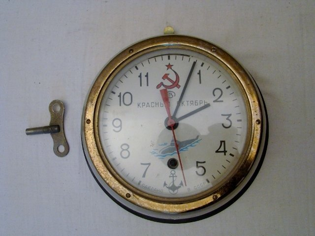 "Russian Atomic Submarine Clock w/key. 9""diam X 4"", 8 da"