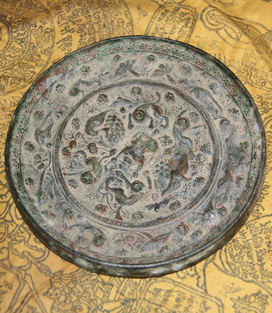 An Important Han Bronze Mirror