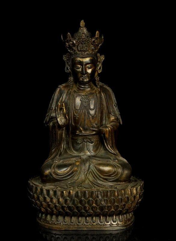 A Chinese Qing Gilted Bronze Tibetan Buddha Figure