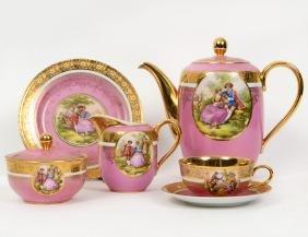 GERMAN PUCE GROUND GILT DECORATED PORCELAIN TEA SERVICE