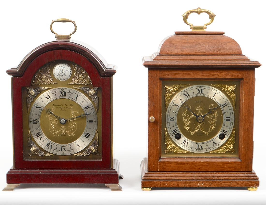 TWO ENGLISH BRASS AND MAHOGANY CARRIAGE CLOCKS