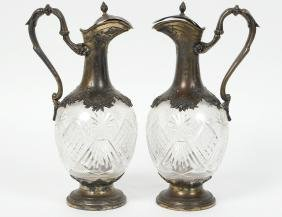PAIR OF CUT GLASS AND SILVER PLATED MOUNTED DECANTERS