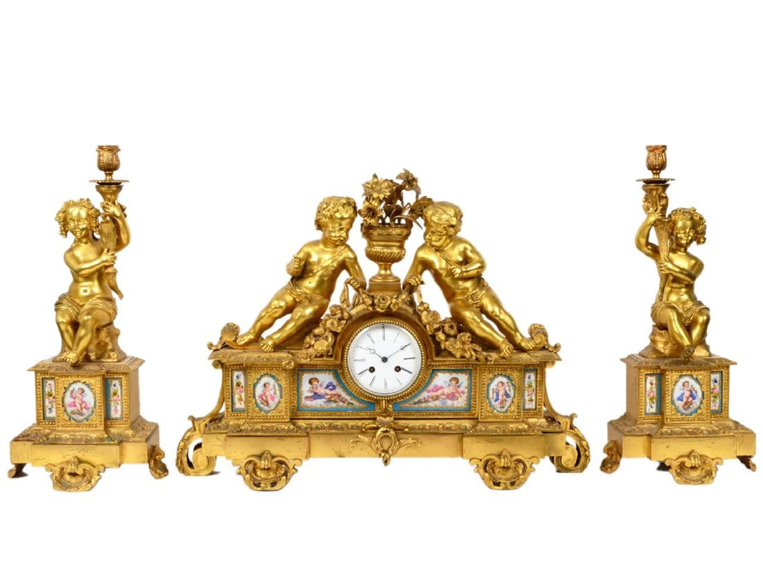 FRENCH ROCOCO STYLE THREE PIECE ORMOLU CLOCK GARNITURE