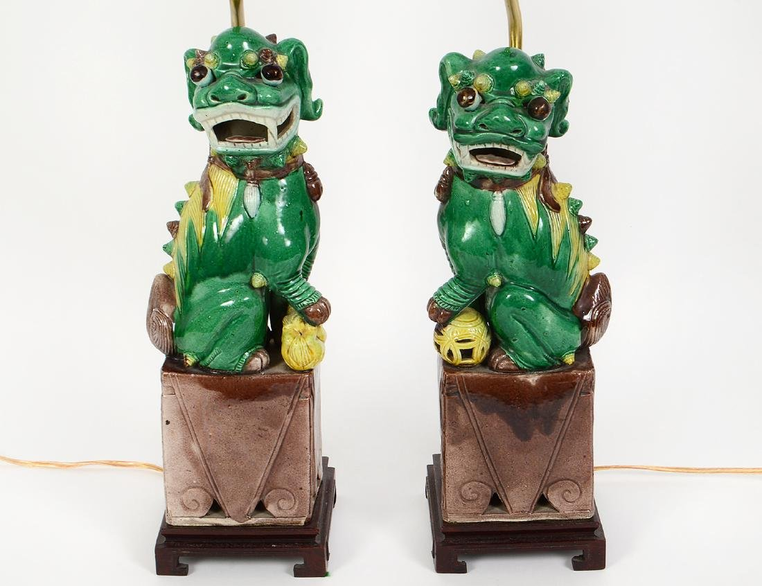 PAIR OF CHINESE SANCI GLAZED PORCELAIN FU-DOG LAMPS