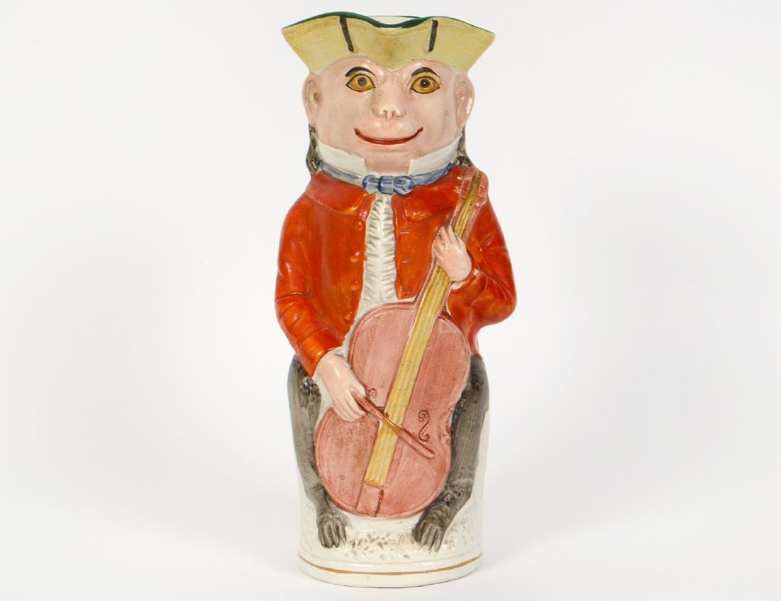 ENGLISH PAINTED EARTHENWARE TOBY JUG