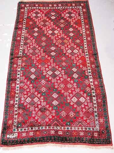 20: Hand Knotted Persian Rug. Slightly Faded Overall,