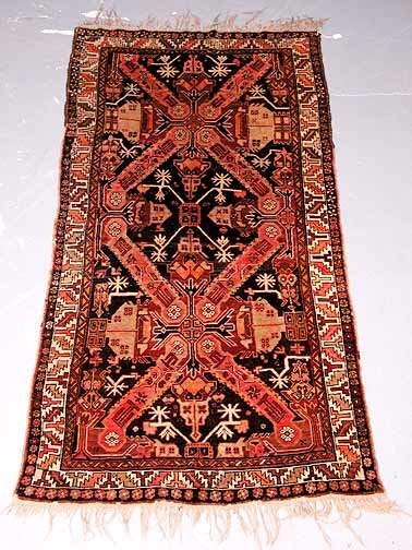 21: Hand Knotted Persian Rug. Good Condition
