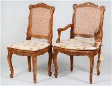 FIVE LOUIS XV STYLE CANED OAK CHAIRS