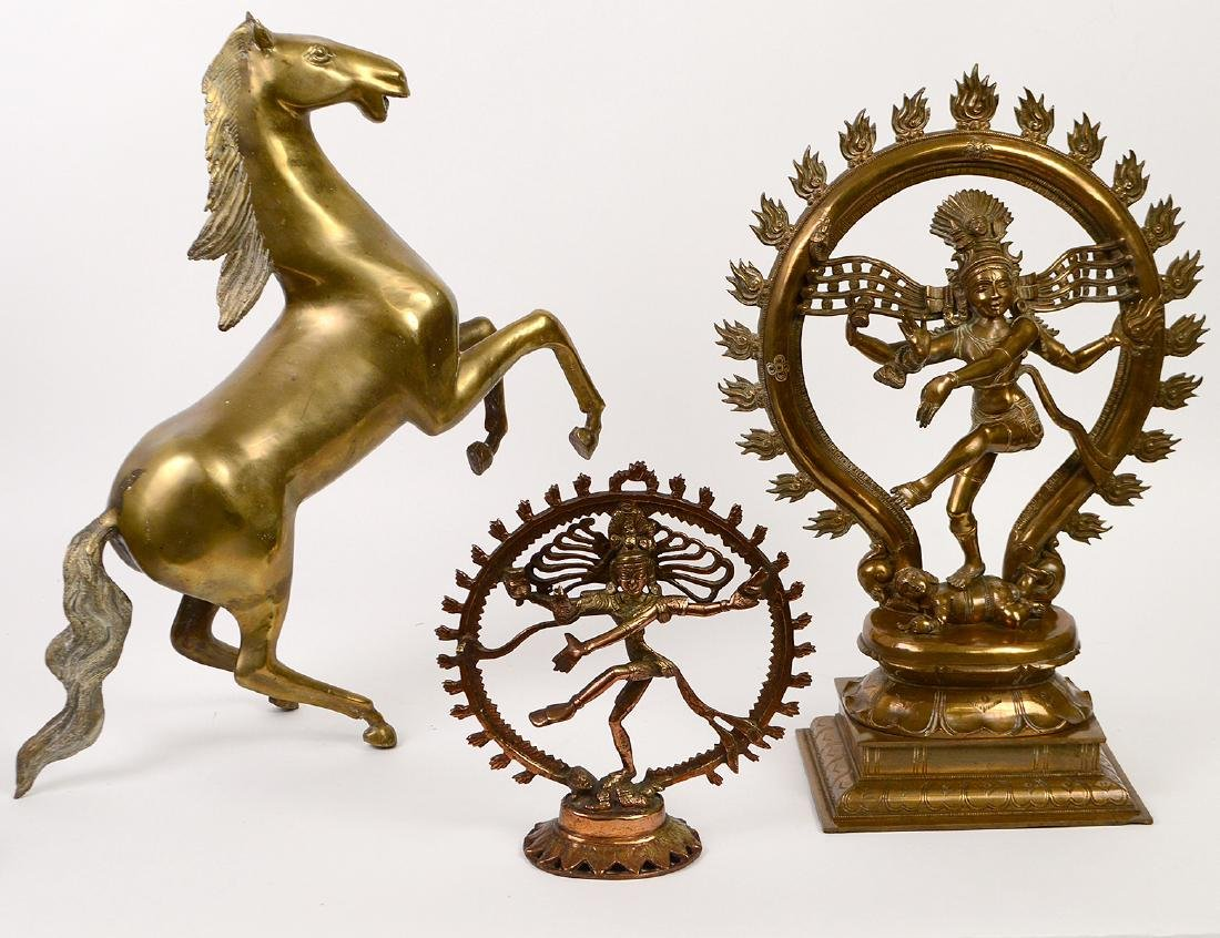 TWO INDIAN BRONZE DIETIES AND A BRASS STALLION